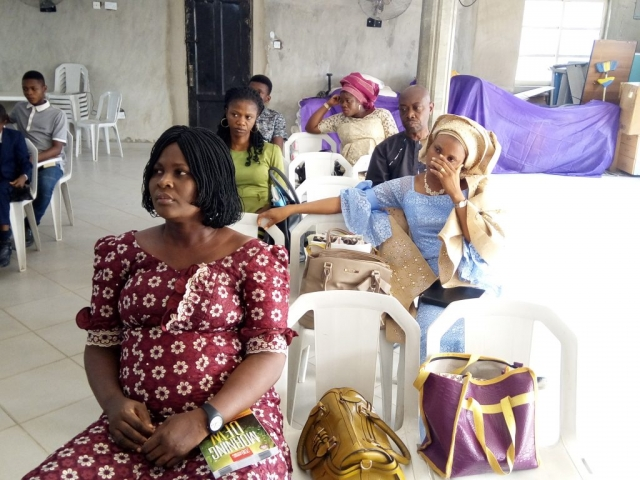 Members Listening to the Gospel